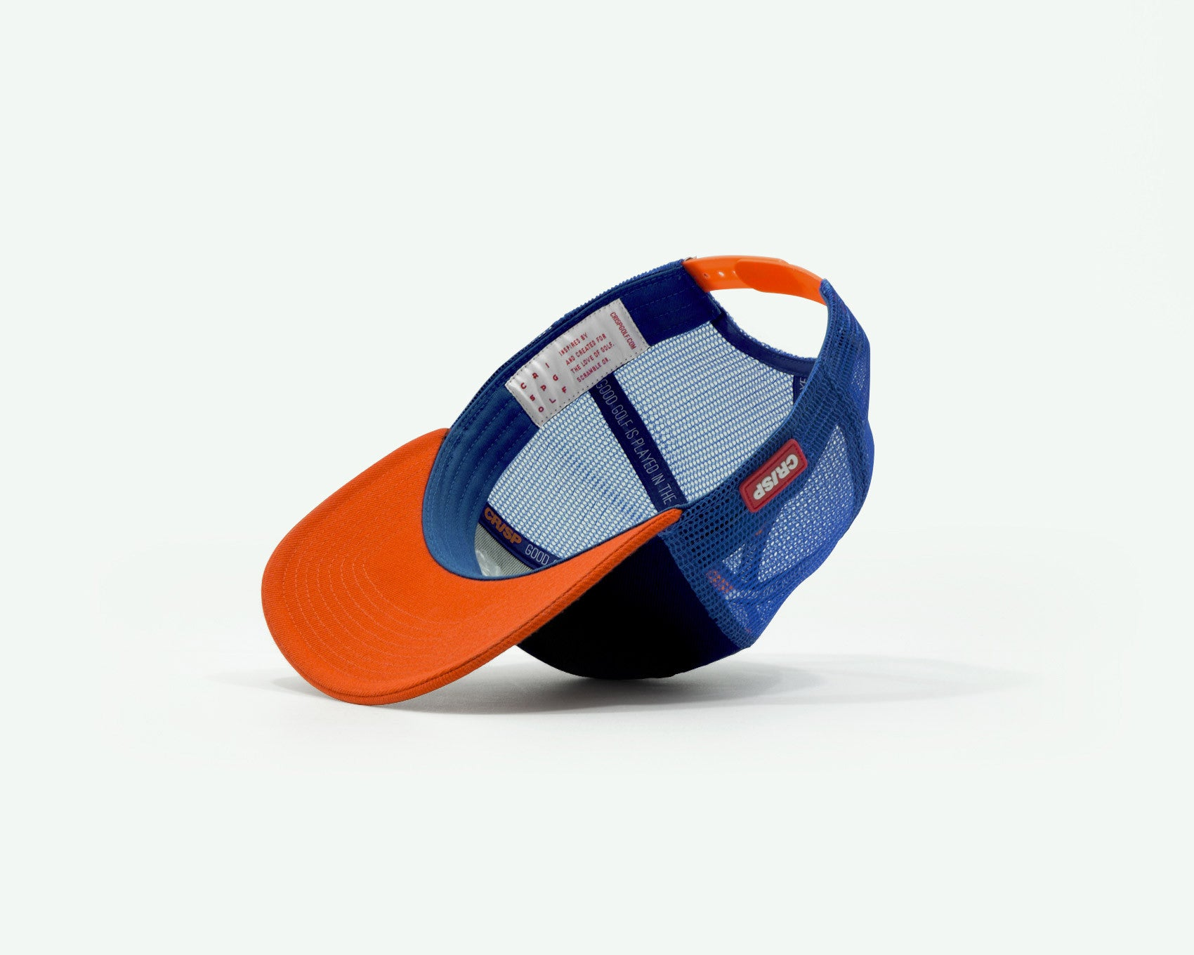 104 series navy blue/orange structured two-tone 6-panel golf cap with a wool brush cotton crown, trucker mesh side/back panels and plastic closure