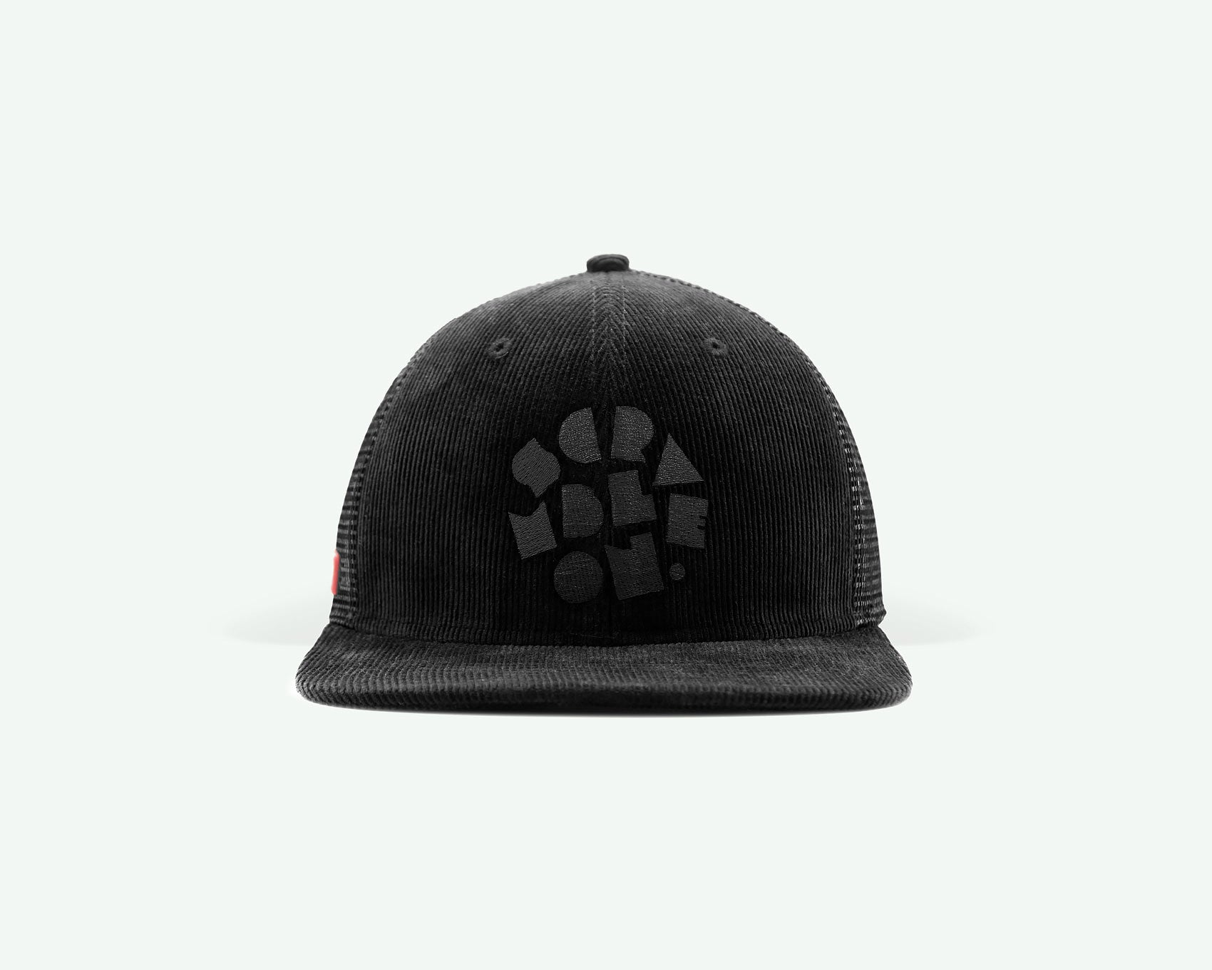 "106 ""scramble on"" series black coloured structured 6-panel golf cap with a corduroy crown, trucker mesh side/back panels, a plastic closure"