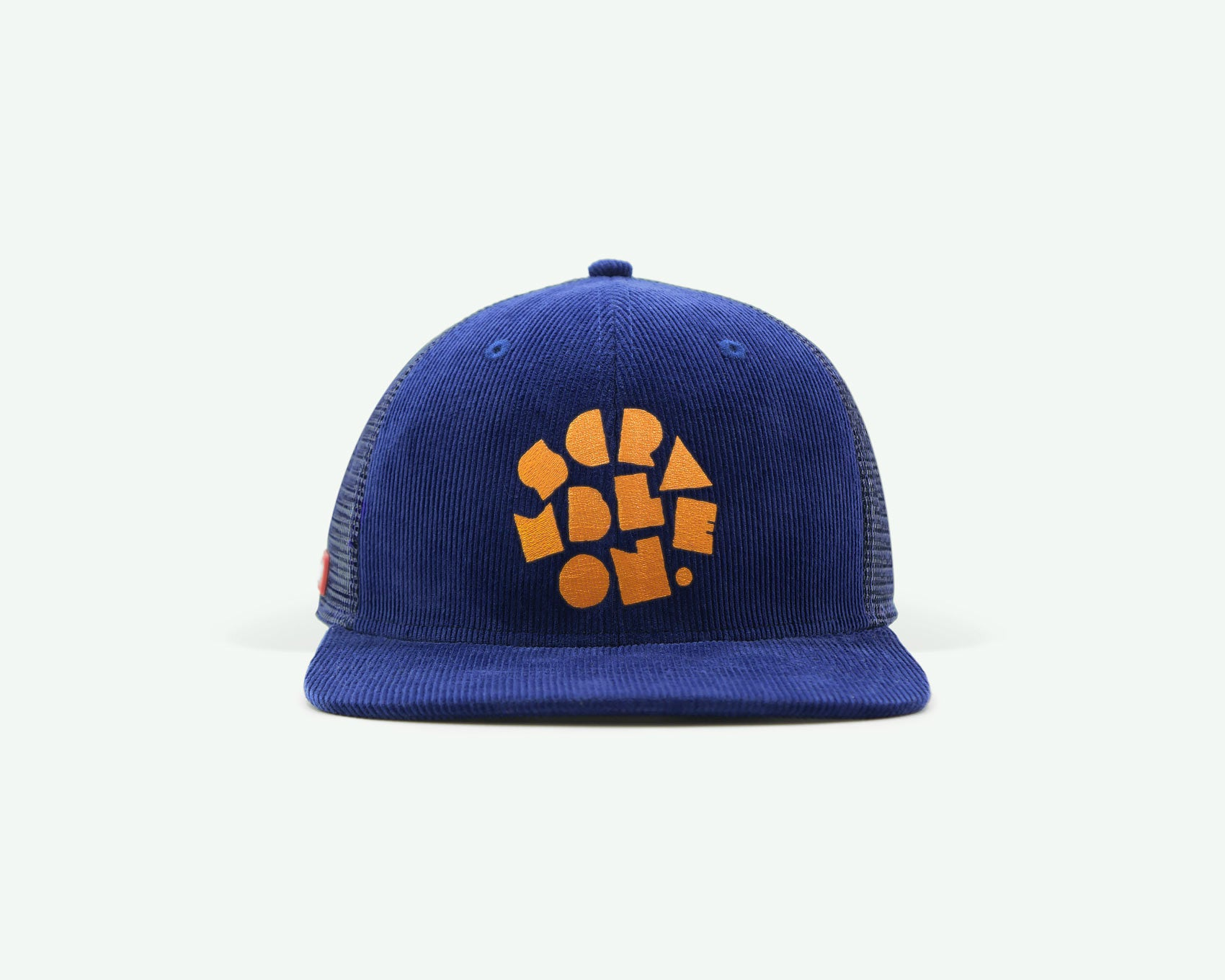 "106 ""scramble on"" series navy blue orange coloured structured 6-panel golf cap with a corduroy crown, trucker mesh side/back panels, a plastic closure"
