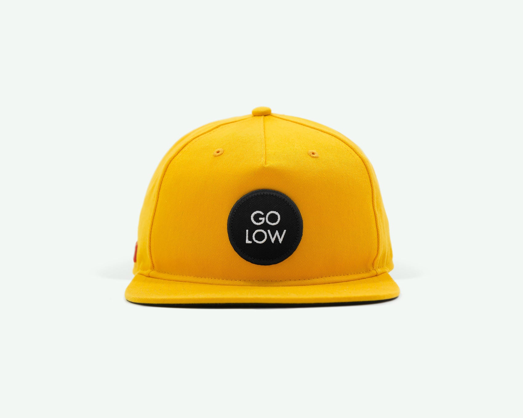 "109 ""Go Low"" Yellow coloured Semi-structured flat brim 5-panel golf cap with black cotton strap, white buckle and an embroidery patch"