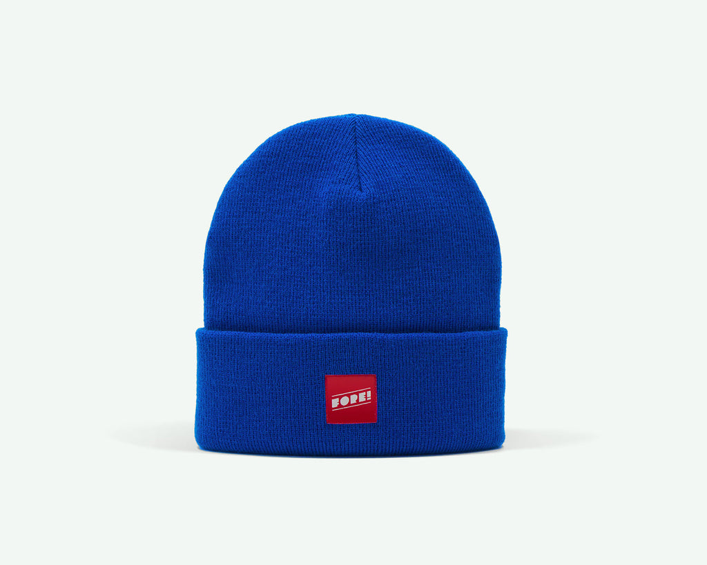 "115 ""FORE"" blue coloured rib-knit golf beanie. 100% acrylic"