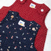 Baby girls sleeveless dress. Navy patterned fabric.