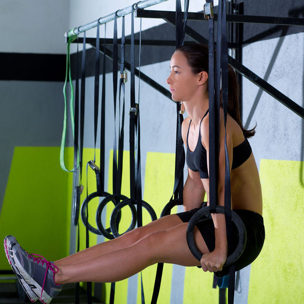 CrossFit Gymnastic Rings - Woman doing l-sit
