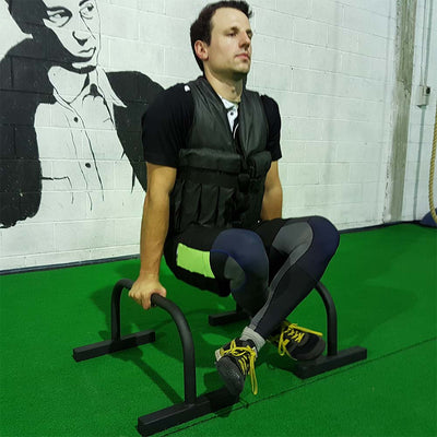 Weight vest for bodyweight exercises - on parallette bars