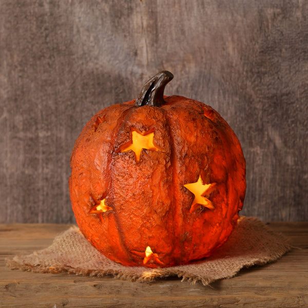 Pumpkin with Light And Star Cutouts