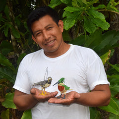 Artisan Edson from San Francisco with woven birds. Photo by Campbell Plowden/Amazon Ecology