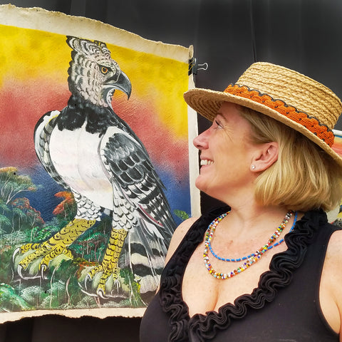 Customer with fair-trade hat band at CACE booth at Falcon Ridge Folk Festival 2019