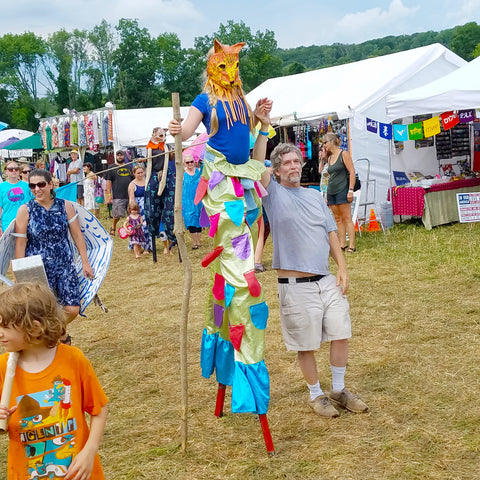 Parade in front of CACE booth at Falcon Ridge Folk Festival 2019