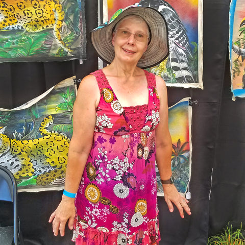 Happy customer at CACE booth at Falcon Ridge Folk Festival 2019