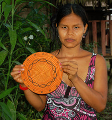 Bora artisan from Brillo Nuevo with woven trivet. Photo by Campbell Plowden/Amazon Ecology