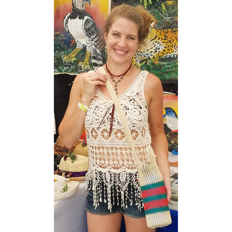 Woman with fair-trade bottle carrier woven with chambira palm fiber at the CACE booth at the Philadelphia Folk Festival 2019