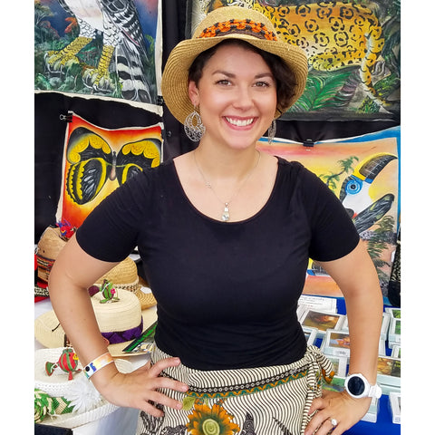 Woman with fair-trade hat band woven with chambira palm fiber at the CACE booth at the Philadelphia Folk Festival 2019