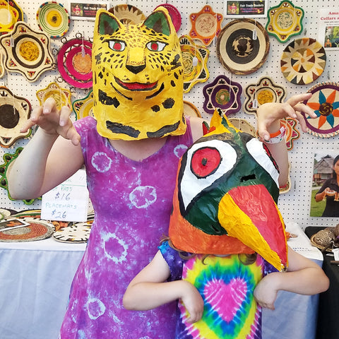 CACE booth visitors with jaguar and toucan masks at the Philadelphia Folk Festival 2019