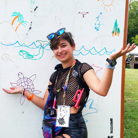 Woman at Community Nature Art mural at the CACE booth at the Philadelphia Folk Festival 2019