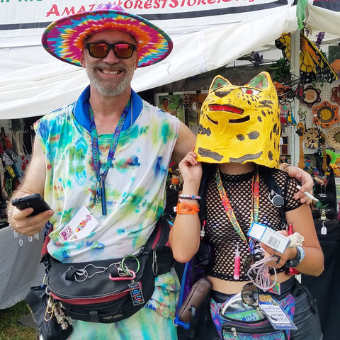 Man and woman with jaguar mask at the CACE booth at the Philadelphia Folk Festival 2019