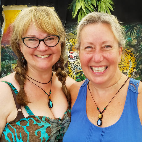 Two friends with ayahuasca vine and stone necklaces at the CACE booth at the Philadelphia Folk Festival 2019