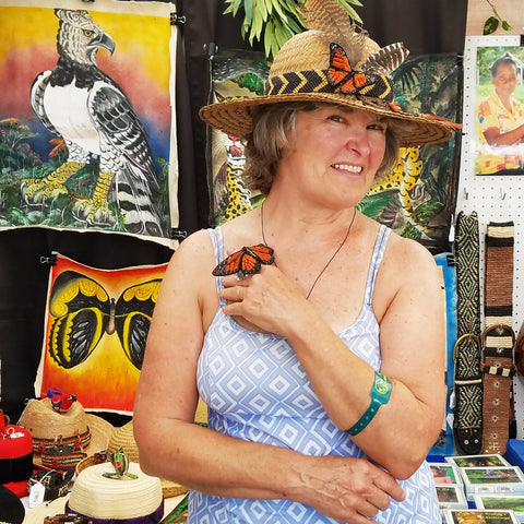 Maureen Gregory with woven butterflies and hat band at the CACE booth at the Philadelphia Folk Festival 2019