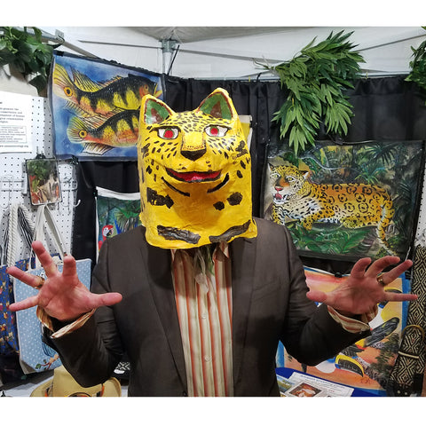 CACE booth visitor with jaguar mask at the Philadelphia Folk Festival 2019