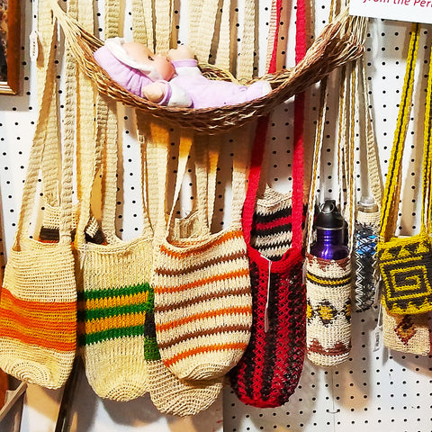 Fair-trade bottle carriers and wine totes woven with chambira palm fiber at the CACE booth at the Philadelphia Folk Festival 2019