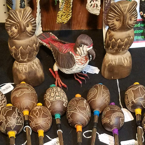 Fair-trade woven hawk, balsa wood owls and calabash maracas at the CACE booth at the Philadelphia Folk Festival 2019