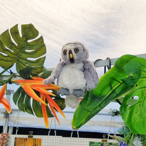 Plush owl with tropical leaves at CACE booth at Rhythm and Roots Festival 2019