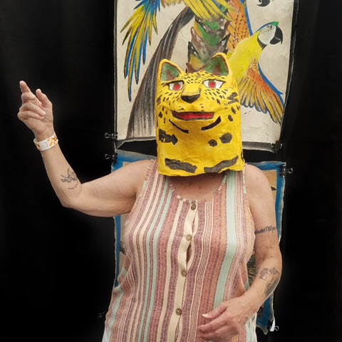 Woman in jaguar mask at CACE booth at Rhythm and Roots Festival 2019