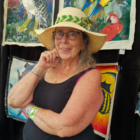 Woman with green and white woven hat band at CACE booth at Rhythm and Roots Festival 2019