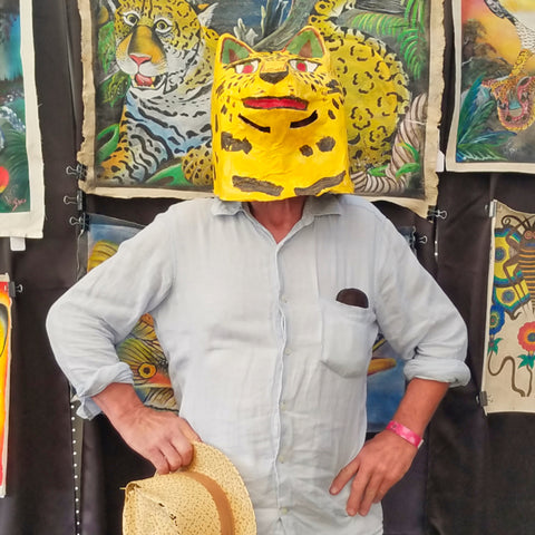 Man in jaguar mask at CACE booth at Rhythm and Roots Festival 2019