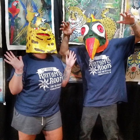 Couple in jaguar and toucan masks at CACE booth at Rhythm and Roots Festival 2019