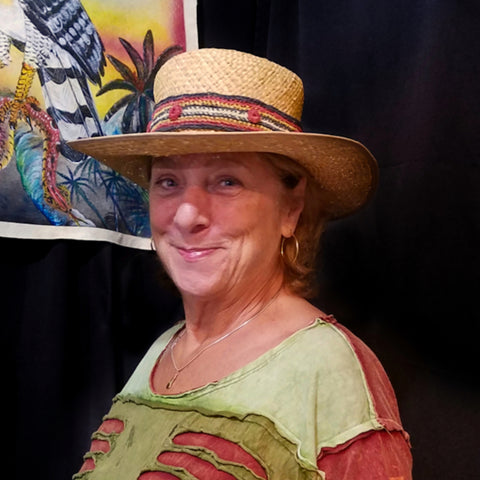 Woman with chambira palm fiber hat band at CACE booth at Rhythm and Roots Festival 2019