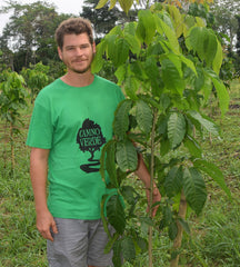 Robin Van Loon with young tree. Photo by Campbell Plowden/Amazon Ecology