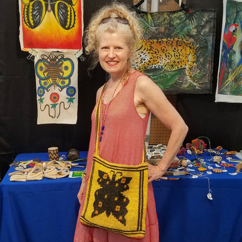 customer with chambira shoulder bag at CACE booth at Romp Festival 2019