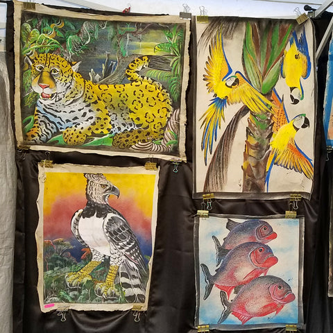 Bora paintings of Amazon wildlife on llanchama tree bark canvass at CACE booth at Romp Festival 2019