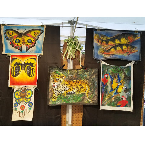Bora artist paintings on llanchama bark canvas at CACE booth at Romp Festival 2019