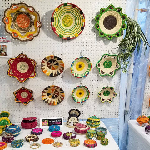 wall of baskets at CACE booth at Romp Festival 2019
