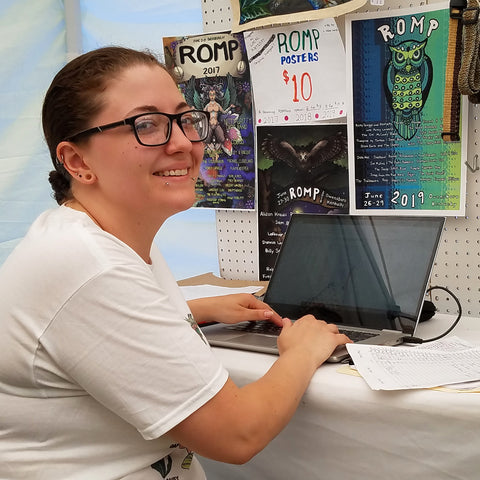 Artist and volunteer Tessa Daniel at CACE booth at Romp Festival 2019