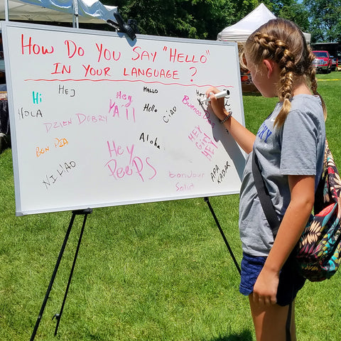 How do say hello sign in front of CACE booth at Romp Festival 2019