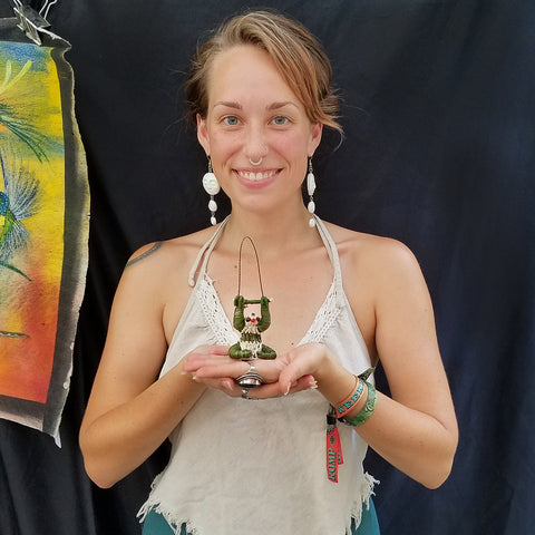 Woman with chambira sloth ornament at CACE booth at Romp Festival 2019
