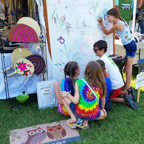 Community art gallery at CACE booth at Romp Festival 2019
