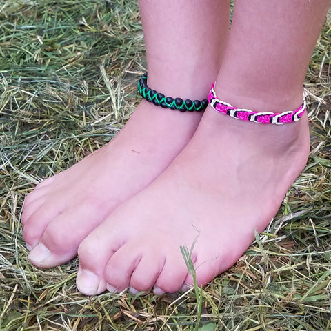 Woman customer with two ankle bracelets at CACE booth at Romp Festival 2019