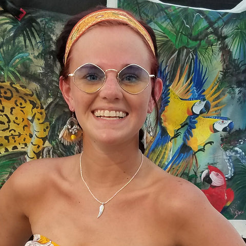 Woman with embroidered head band at CACE booth at Romp Festival 2019