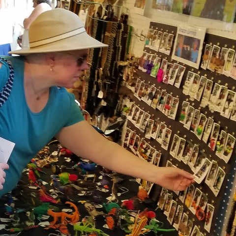 Woman chooses earrings at the CACE booth at the Strawberry Festival 2019