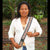 GS01G: Native artisan Monica Chichaco with custom Amazon anaconda guitar strap -
