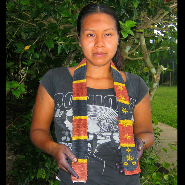 GS02C: Native artisan Gisela Ruiz with Amazon guitar strap - coral snake model