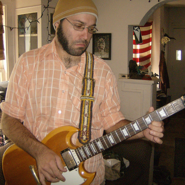 GS06A: David Imburgia with Amazon guitar strap at home - bushmaster model
