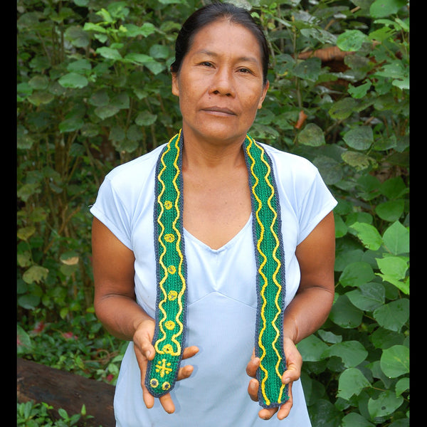 GS10A: Native artisan Angelina Torres with Amazon guitar strap - emerald tree boa model