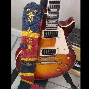 GSL02C: Capt. Dan guitar with wide Amazon Guitar Strap - coral snake model