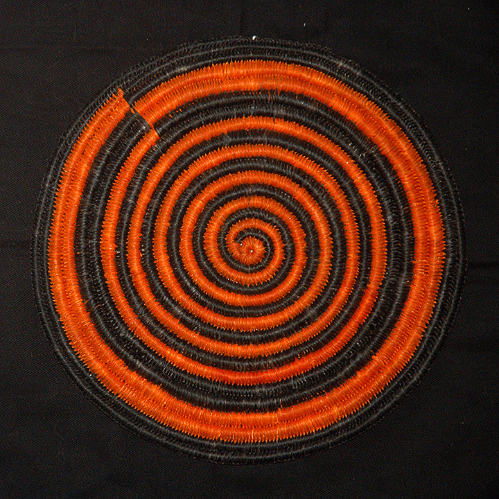 Woven hot pad (tivet) and center piece with black and orange spirals (TP092)