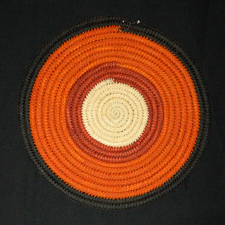 Woven hot pad (trivet) and center piece with earth-tone bands (TP107)