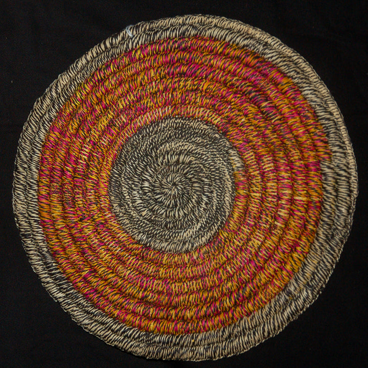 Woven hot pad (trivet) and center piece with blended pink and yellow rings (TP116)